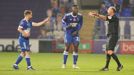 Alan Judge points the finger at referee Andy Haines and Toto Nsiala appeals after Portsmouth had sco