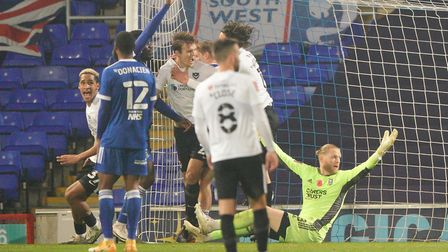 Sean Raggetts celebrates his controversial winner in the second period of stoppage time, as Ipswich