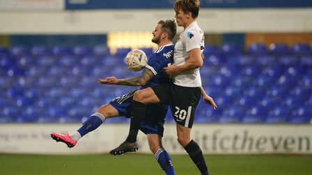 James Norwood has Sean Raggett in close attendance as he chests down the ball.Picture: Steve Wa