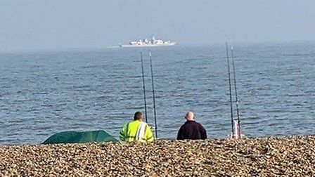 HMS Richmond seen in distance off Sizewell paying tribute to Wendy Botterill Picture: FLEUR VEEVERS-
