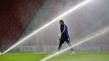 Goalkeeper David Cornell walks through the sprinklers at Doncaster Rovers. Picture Pagepix Ltd