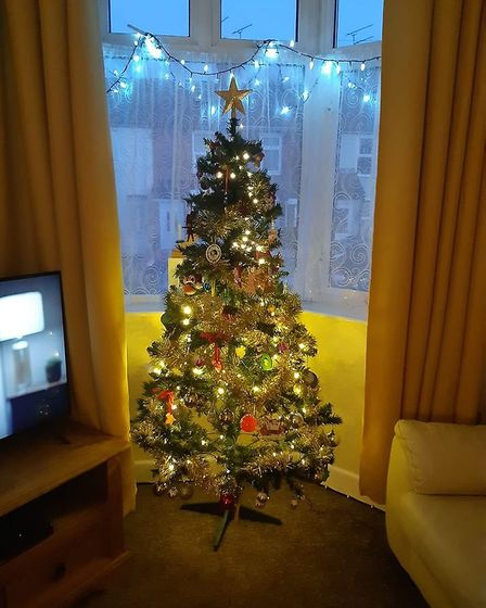 Sarah Snelling put a Christmas tree in her window Picture: SARAH SNELLING