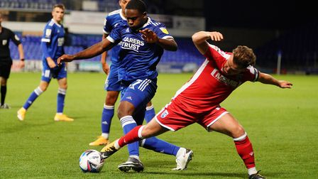 Tyreece Simpson in a battle with Gillingham skipper Alex MacDonald in the EFL Trophy. Picture: S