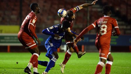 Levi Andoh with a header from a second half corner at Crawley Town Picture Pagepix Ltd