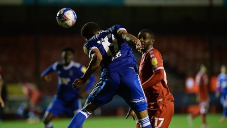 Corrie Ndaba puts everything into a header from a corner at Crawley Town. Picture: Pagepix Ltd