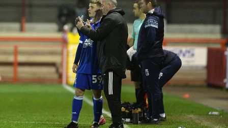 Paul Lambert gives instructions to history-maker Jack Manly at Crawley Town last night Picture: PAGE