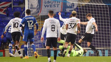 Sean Raggett (right) scores a controversial winner for Portsmouth. Picture: Steve Waller