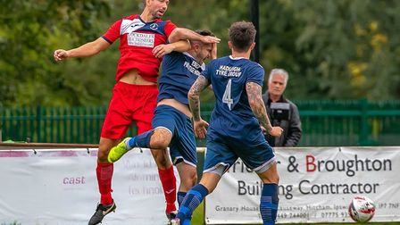 Action at Millfield: Woodbridge Town's Mark Ray clashes with Hadleigh's Kris Rose during the hosts'