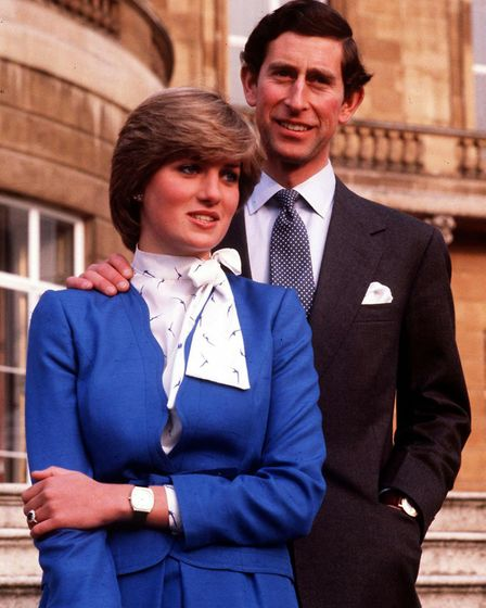 Prince Charles and the then Lady Diana Spencer, wearing her famous blue suit, after the announcement