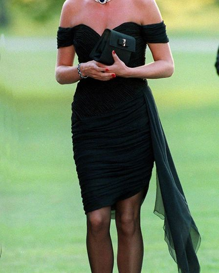 Diana, Princess of Wales wearing a black pleated chiffon dress, with floating side panel, by Christi
