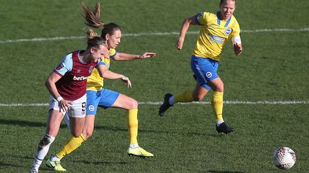 Martha Thomas of West Ham tangles with Kayleigh Green of Brighton during West Ham United Women vs Br