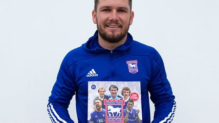 Striker James Norwood with the new sticker album Picture: ITFC