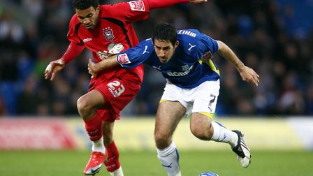 Carlos Edwards, left, in action against Cardiff's Peter Whittingham during a rare Town victory, in N