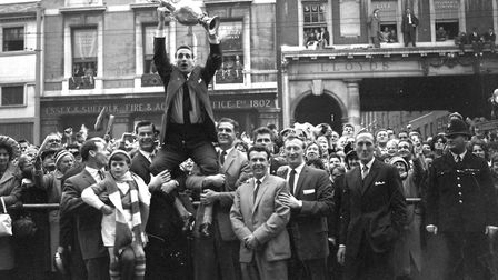 Ipswich Town Captain Andy Nelson holding the Division One Championship Trophy on the Cornhill, Ipswi