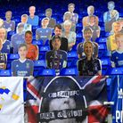 Cardboard cut-outs of Ipswich Town fans. Photo: PA