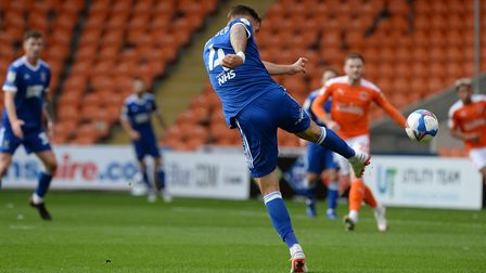 Luke Chambers fires a searing shot on target to give Ipswich a first half lead at Blackpool. Picture