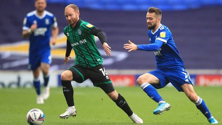 Rochdale's Matt Done (left) and Ipswich Town's Gwion Edwards battle for the ball during the Sky Bet