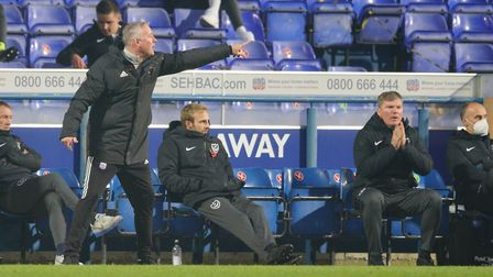 Town manager Paul Lambert directing from the touchline as Portsmouth team manager Kenny Jackett look