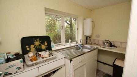 The kitchen inside the former church hall in the Helmingham Estate which is up for sale for £150,000