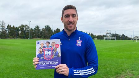 Stephen Ward with the new Ipswich Town sticker album Picture: ITFC