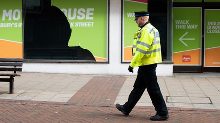 A police officer walks through Ipswich during the first coronavirus lockdown. Picture: SARAH LUCY BR
