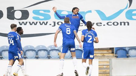 Jevani Brown, Colchester United celebrates the opening goal for the hosts during Colchester United v