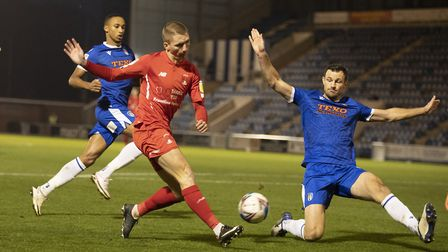 Sam Ling, Leyton Orient cross is blocked by Tommy Smith, Colchester United during Colchester United