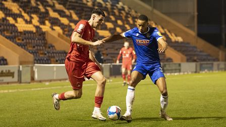 Connor Wilkinson, Leyton Orient looks to get beyond Cohen Bramall, Colchester United during Colchest