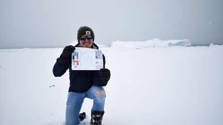 Esther Alatishe's flag shows a map of the frozen continent surrouned by flags of nations which lay c