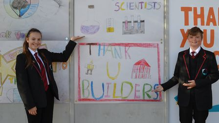Kaia Heffer and Harvey Coe both with their artwork thanking scientists and builders Picture: RG CART
