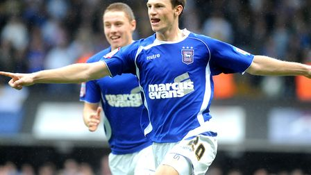 Tommy Smith celebrates scoring against Leeds United, with team-mate Connor Wickham, in 2010. Picture