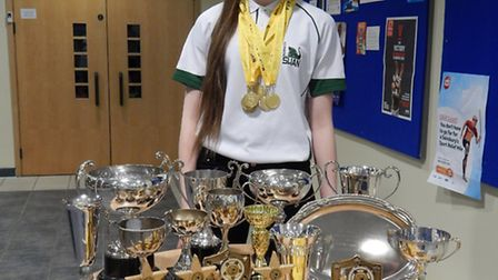 Norwich Swan Swimming Club's Laura Marzolini with her Norfolk County Championships trophy and medal