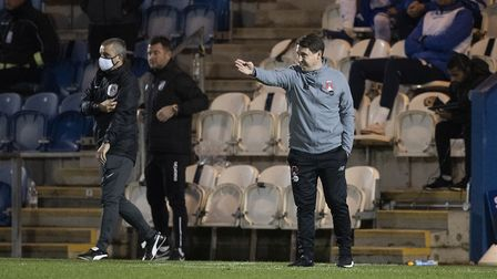 Ross Embleton, Manager, Leyton Orient offers instruction from the technical area during Colchester