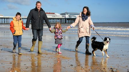 Lucy Downing, new brand manager of Visit North Norfolk. Pictured with her husband Robert, children R