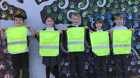 A group of pupils at Tollgate Primary School, in Bury St Edmunds, with the kit bags donated by David