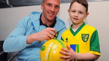 The NCFC Open Day. John Ruddy signs his autograph for Aiden Robertson, 6. Picture: Denise Bradley