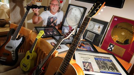 Barry Holden and the rock memorabilia he's collected for his Live Aid auction in North Walsham. PHOT