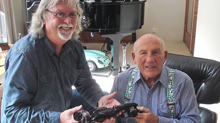 Barry Holden collecting a F1 car wine bottle from Sir Stirling Moss for the auction. PHOTO: submitte