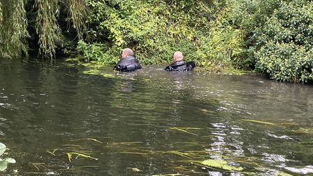 Diving teams searched the river after the discovery Pictures: ELLA WILKINSON