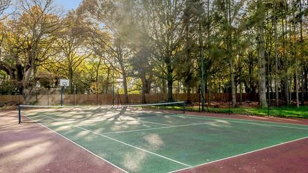 A tennis court can be found on the property Picture: STRUTT & PARKER