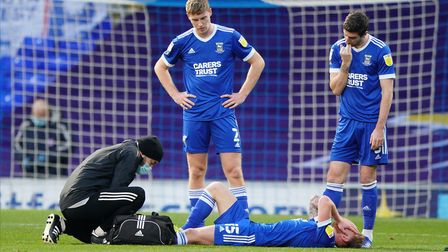 Mark McGuinness and Stephen Ward look concerned as Teddy Bishop receives attention.Picture: St