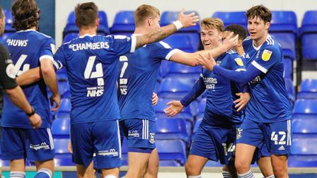 Towns players celebrate with Jack Lankaster, after he had scored the winner in the 2-1 victory over