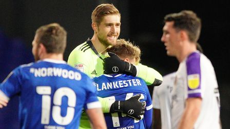 Ipswich keeper Tomas Holy celebrates with the scorer of Towns winner, Jack Lankaster, after the fina