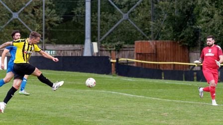 Match action: Christy Finch scores the only goal of the game during Stowmarket Town's 1-0 home win o