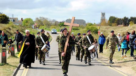 The Way of the Walk Cross through Winterton on Good Friday.The cross is carried towards the beach.Pi