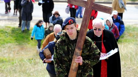 The Way of the Walk Cross through Winterton on Good Friday.The cross is carried up onto the dunes.Pi