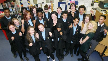 'Good school': Valerie Dennis smiles for the camera with her pupils. Ofsted inspectors praised Eastbrook for its good...