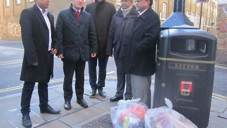 John Biggs (second from left) in Brick Lane on campaign trail to clean up the streets, with council candidates Tarik Khan,...