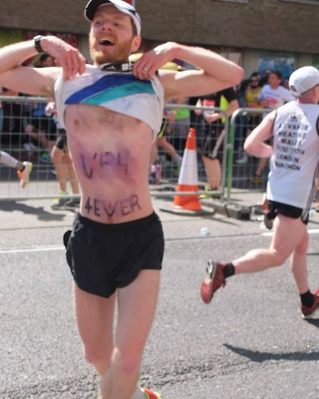 Simeon Bennett, 37, during the marathon showing the love for his team