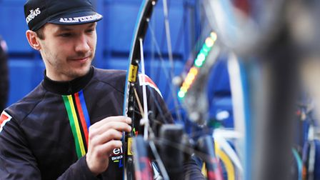 Krzysztof Wierzbicki, of Velove Poland, checks a bike after a demonstration of Tannus' non-puncture polymer tyre over glass.